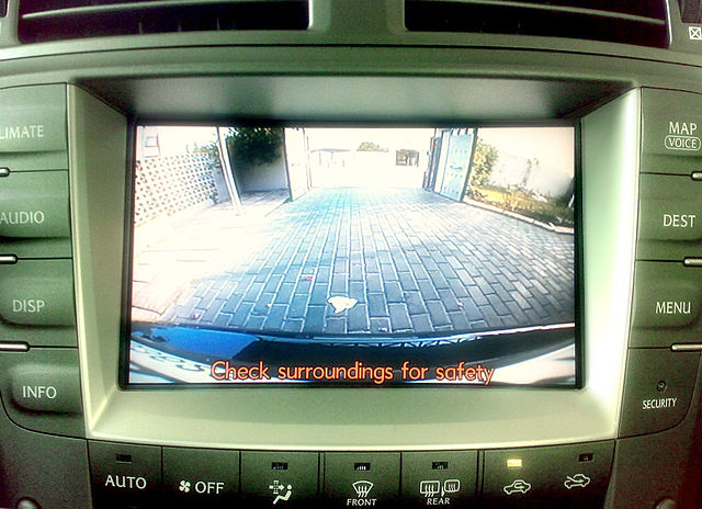 BACKUP CAMERAS. Backup cameras, like this one on the navigation screen of a Lexus IS 250, allow drivers to view objects in their path while reversing. Photo from Wikimedia Commons