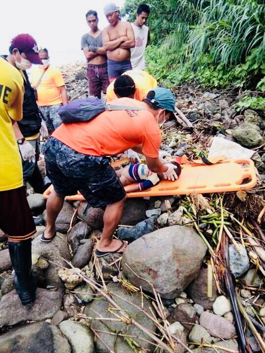 REVIVAL. Responders rescue a child from the landslide area in Patitinan, Sagñay, Camarines Sur. Photo courtesy of Radel Chavez Jr