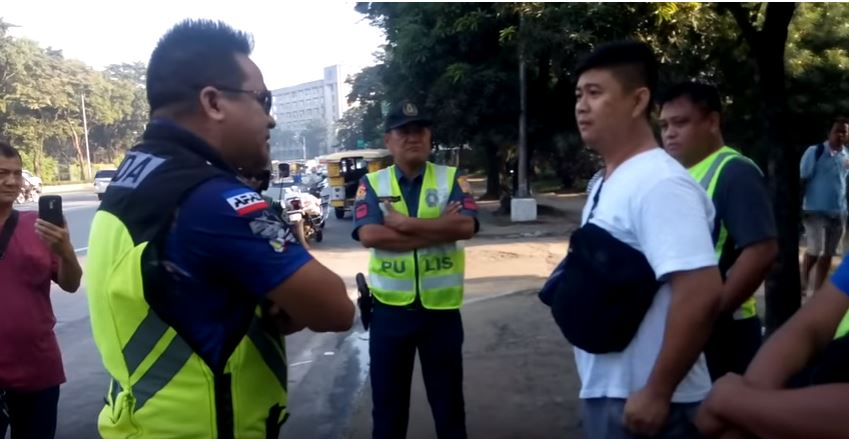 THREAT. MMDA enforcer Nebrija (left) posted a video on Facebook showing police officer SPO2 Aguilar (middle) threatening them not to tow his 'colorum' jeepney. Screenshot from Edison Bong Nebrija Facebook Page