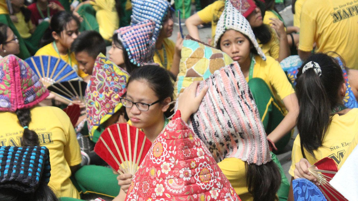 PREPAREDNESS. Sta Elena High School students wear their makeshift headgear during an earthquake drill. Photo courtesy of Giovanna Jean Nesas