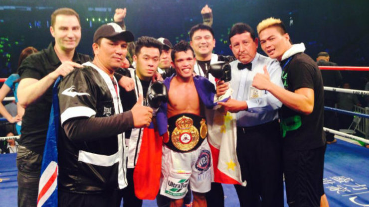 CHAMPION. Randy Petalcorin is all smiles after KOing Walter Tello. Photo by Team Petalcorin