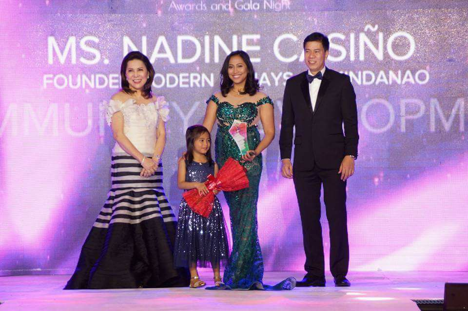 WOMAN OF SIGNIFICANCE. Nadine Casino receives her award with daughter and Tourism Secretary Wanda Teo. Photo from Nadine Casiño