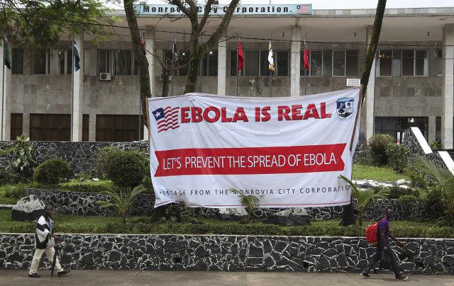 http://assets.rappler.com/612F469A6EA84F6BAE882D2B94A4B421/img/DC8A6838D1AE4C7AA19C623C8DA42338/ebola-liberia-epa-h_51502865-20140801.jpg