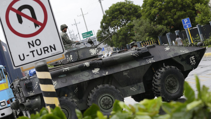 NO COUP: A convoy of military trucks seen on Manila roads prompted coup rumors. Photo by Dennis Sabangan/EPA
