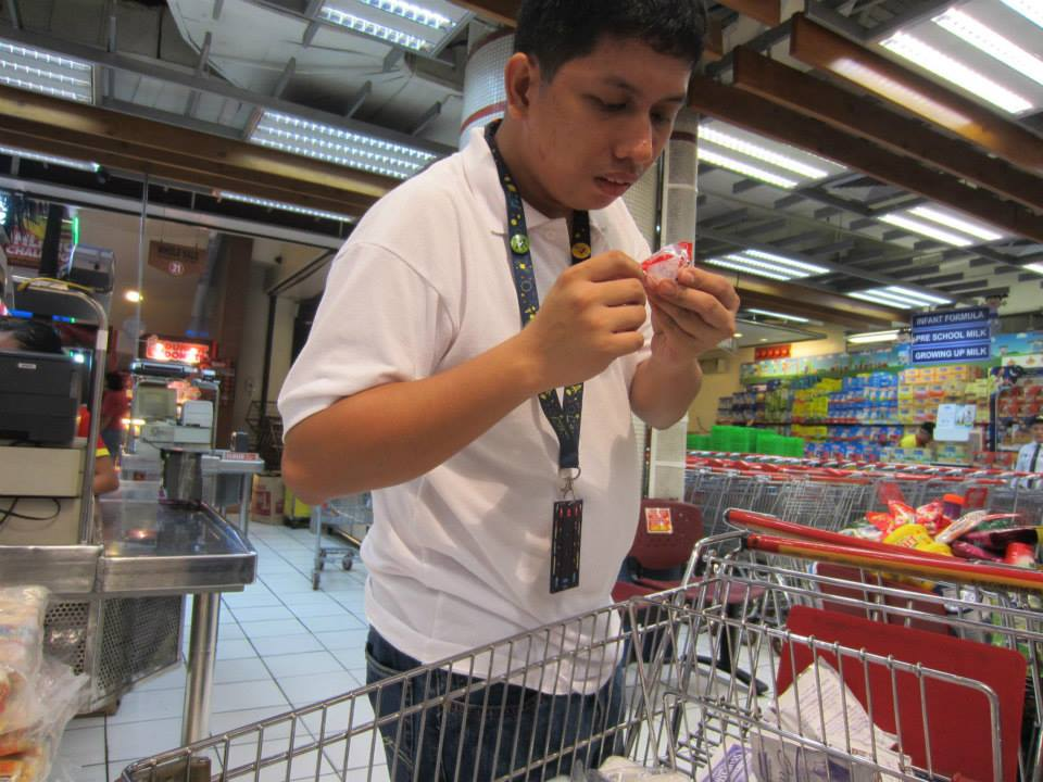 INCLUSION. Angelo Jardeleza checks out an item to be returned to its display area during his volunteer work at Iloilo Supermart. Photo by Ted Aldwin Ong/Rappler