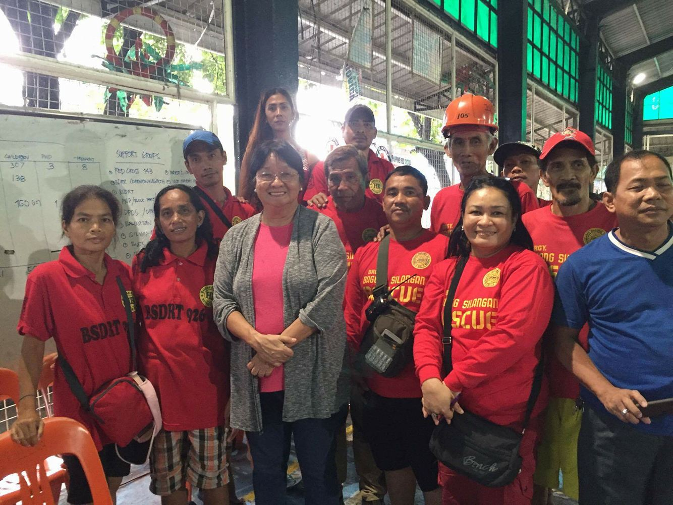 EVACUATION CENTER. DSWD Secretary Judy Taguiwalo and volunteers visit an evacuation center in Barangay Bagong Silangan, Quezon City, on August 14, 2016. Photo by DSWD
