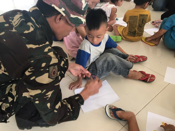 EVACUATION CENTERS. Through the psychosocial program, the soldiers hope to help divert the children's attention away from the trauma caused by the war.