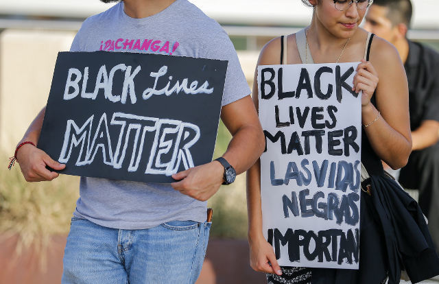 BLACK LIVES MATTER. A small group of Black Lives Matter protesters meet on the Ronald Kirk Pedestrian Bridge in Dallas, Texas, USA, July 10, 2016. Photo by Erik S. Lesser/EPA
