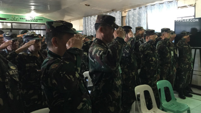 READY RESERVE. Members of the NCR Regional Community Defense Group, Army Reserve Command, salute the Philippine Flag in a seminar on Project Agos.