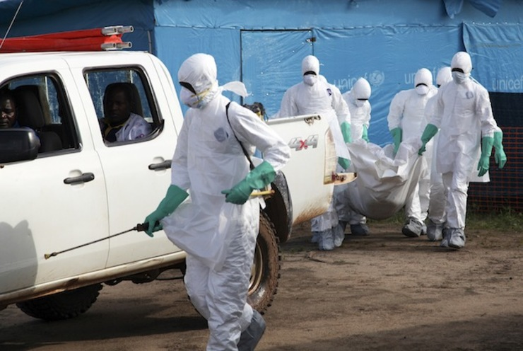 HEALTH WORKERS. A photograph made available 27 July 2014 shows Liberian health workers in protective gear on the way to bury a woman who died of the Ebola virus from the isolation unit in Foya, Lofa County, Liberia, 02 July 2014. Ahmed Jallanzo/EPA