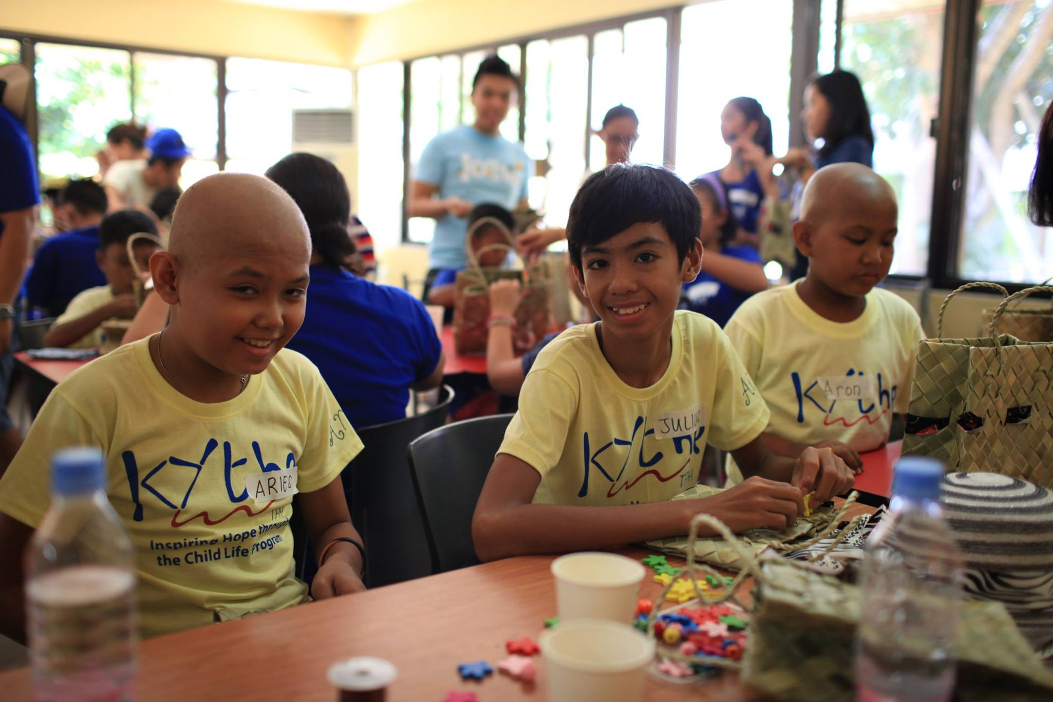 SIMPLE JOYS. Some of Kythe's kids make arts and crafts during one of the organization's events. Photo from Kythe