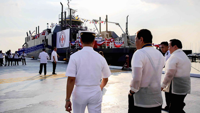 M/V AMAZING GRACE. President Rodrigo Roa Duterte is accompanied by Philippine Red Cross (PRC) Chairman Senator Richard Gordon for a tour on the M/V Amazing Grace during its launching at the Philippine Navy Headquarters in Manila on May 9, 2017. Malacañang photo