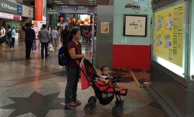 UNDOCUMENTED. 37-year old Erika* with her 11-month old son in Kuala Lumpur. Photo by Camille Elemia/Rappler.com