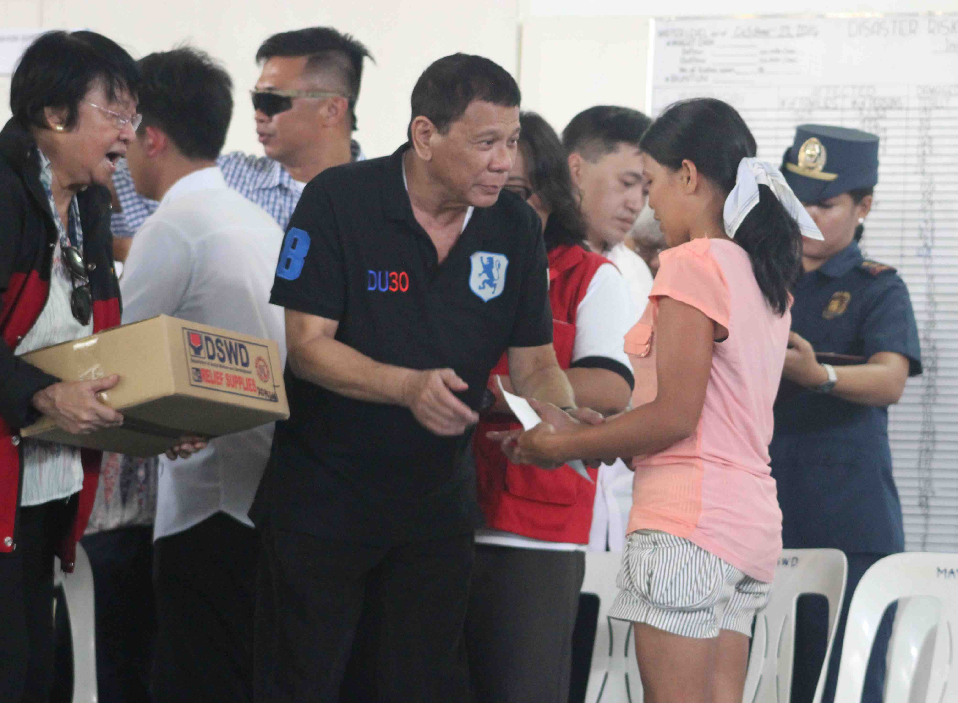 AID DISTRIBUTION. Pres Rodrigo Duterte and DSWD Sec Judy Taguiwalo kick off the distribution of emergency shelter assistance (ESA) in Tuguegarao City and Ilagan City on Sunday, October 23. Photo by Julius Catulin