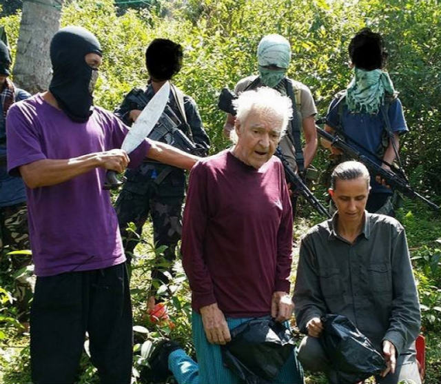 ABU SAYYAF. A frame grab from video released by the Abu Sayyaf reportedly shows German hostages iwhile being held by the Abu Sayyaf in the Philippines. The two were eventually released. Screen grab from Aby Sayyaf video