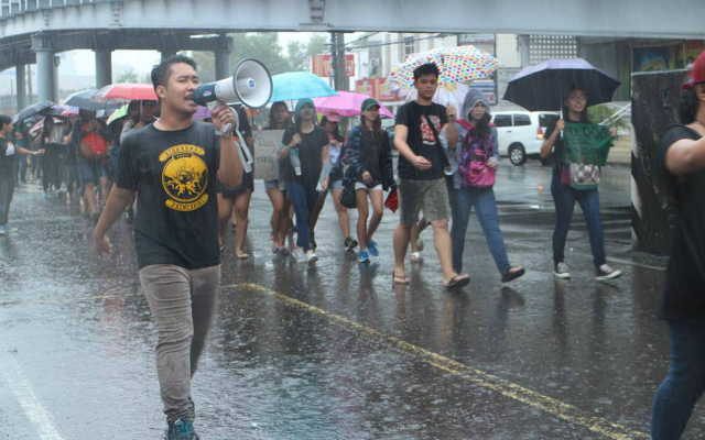 NOT A HERO. Ilonggo activists march to protest the stealthy burial of the late dictator Ferdinand Marcos. Photo by Russel Patina/Rappler