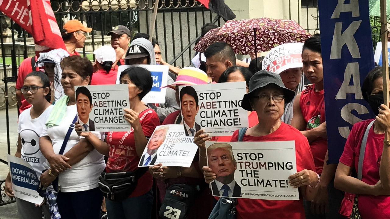 CLIMATE DENIER. Climate justice group Philippine Movement for Climate Justice calls on ASEAN leaders to shift to renewable energy. Photo by Aika Rey/Rappler