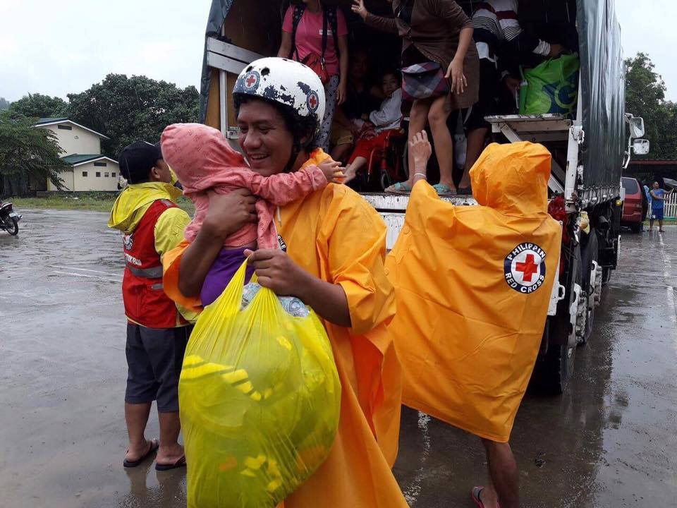 ALWAYS THERE. Philippine Red Cross staff and volunteers assist in the evacuation of families affected by Tropical Storm Vinta in Cagayan de Oro. Photo by PRC