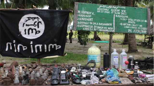 ATTACKS: This file photo shows Al Qaeda's black flag that was seized in a BIFF camp in February 2014. Military photo
