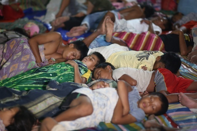 DISPLACED. People displaced by fighting sleep at an evacuation center. File photo by Ferdinandh Cabrera