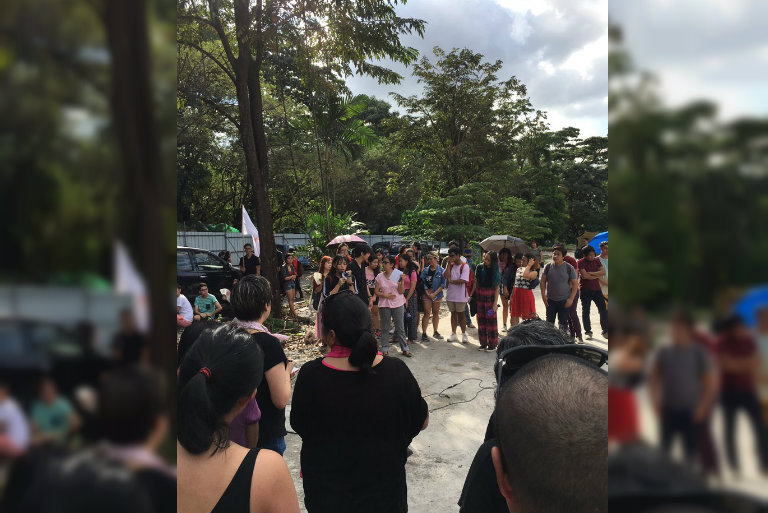 WALKOUT. Students and members of the faculty gather at the old Faculty Center grounds to condemn the fraternity-related violence happening in UP. Photo courtesy of Gita Labrador