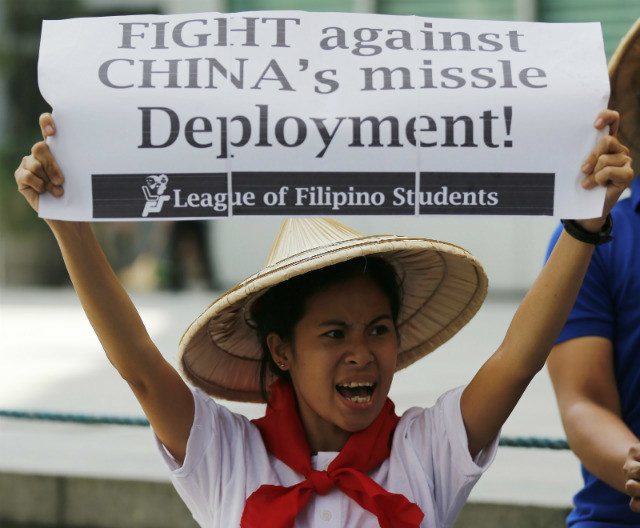 SLAMMING CHINA. Filipinos stage a demonstration on February 19, 2016, to protest against China's reported deployment of a surface-to-air missile system in the disputed South China Sea. Photo by Francis Malasig/EPA