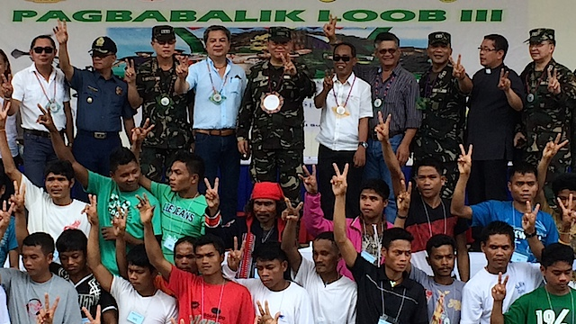 PEACE SIGN: File photo of former AFP chief General Emmanuel Bautista with NPA rebels who surrendered in Eastern Mindanao. AFP-PAO photo