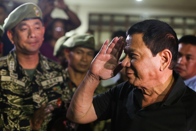 SALUTE. In this file photo, President Duterte visits the wake of slain Captain Clinton Capio at the Libingan ng mga Bayani in Fort Bonifacio on January 16, 2017. File photo courtesy of Malacañang