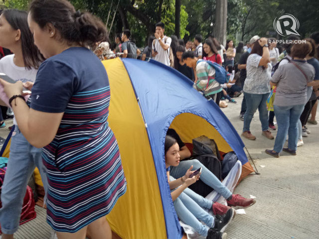 LOOK: UPCAT applicants camp out, faint lining up in Diliman