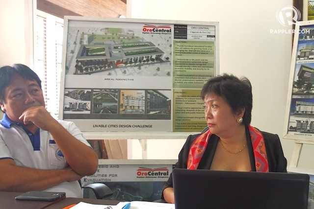 NEW CITY CENTER. Engineer Isidro Borja (left), Cagayan de Oro's top planning and development officer; and Eileen San Juan, the city's chief for Local Economics, Investment Promotion, discuss the planned Cagayan de Oro city expansion. Photo by Bobby Lagsa/Rappler.
