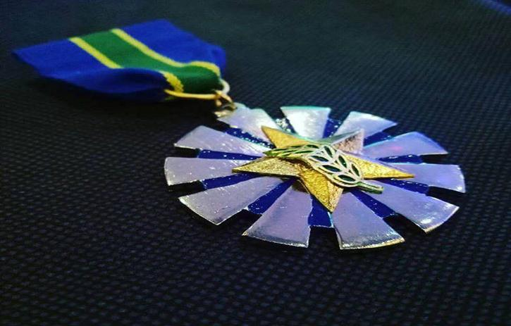 AFP AWARD. The AFP's 'Gawad sa Kaunlaran' is the second to the highest distinction given to citizens and government officials in accordance with socio-economic and other non-combat activities. Photo courtesy of Peter Khallil Figueroa Ferrer