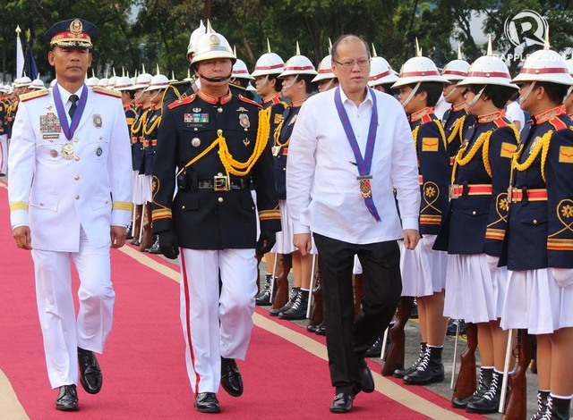 RETIREMENT. President Benigno Aquino III (right) troops the line at the retirement ceremony held for Philippine National Police Director General Ricardo Marquez (left) at Camp Crame on June 28, 2016. Photo by Joel Liporada/Rappler