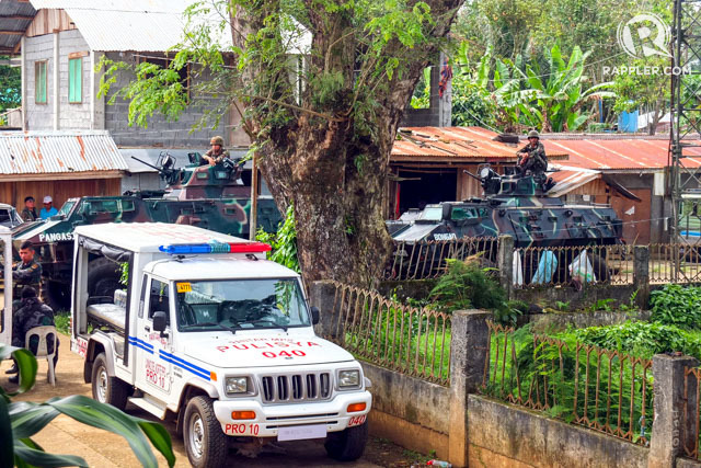 ARMY TANKS. V150 Simba armored vehicles guard the Pantar Municipal Hall. Photo by Bobby Lagsa/Rappler
