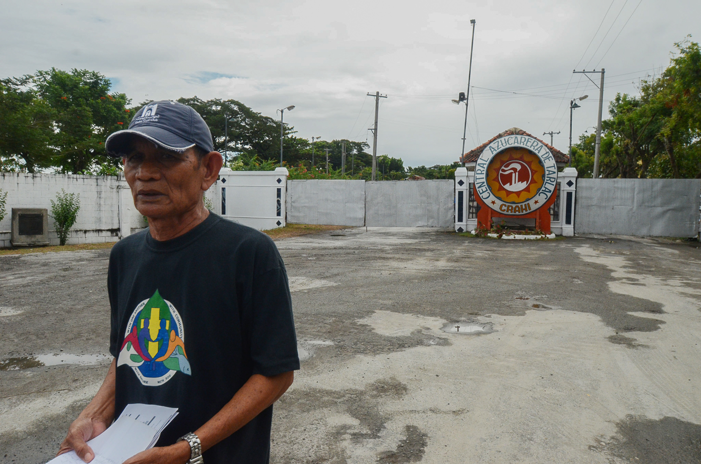 IN GRIEF. Pastor Gab Sanchez prepares his speech in front of the Central Azucarera De Tarlac. Sanchez lost his son Juancho, 20 years old then, when he was fatally shot.