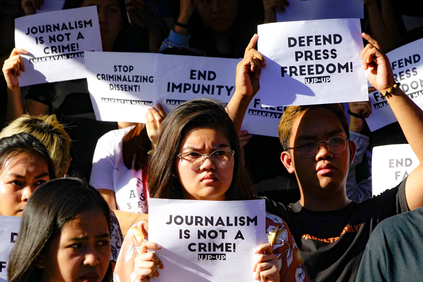 PROTEST. Youth groups conduct quick reaction mobilization to condemn the sudden arrest of Rappler's Maria Ressa and continous threats of the Duterte government against the right to press freedom at University of the Philippines College of Mass Communication. Photo by Maria Tan/Rappler
