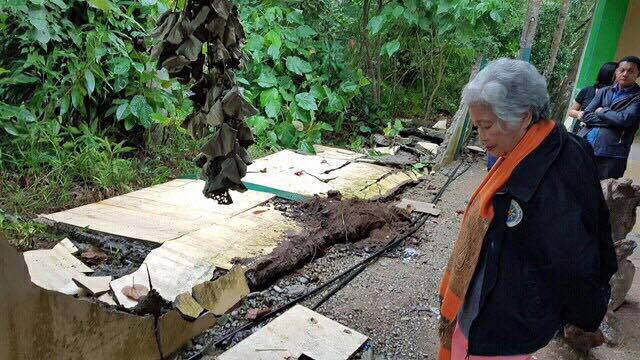 BROKEN. Education secretary Leonor Briones inspects a school damaged by the 6.7 magnitude earthquake that struck Northern Mindanao on February 10. Photo by DepEd