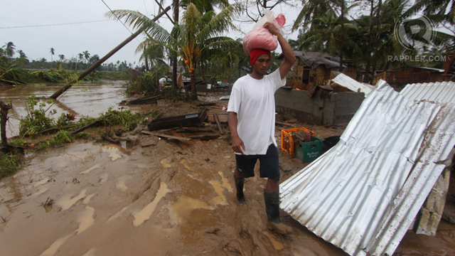 "COVERED IN MUD. This is what typhoon ""Pablo"" did to many towns in the province. Photo by Karlos Manlupig"