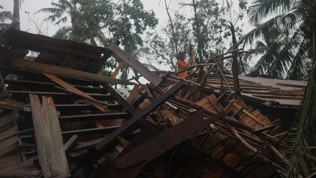 DEVASTATED. The storm uprooted trees and tore roofs off houses and nipa huts. Photo by Karlos Manlupig