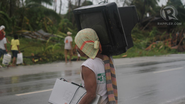 "WASHED AWAY. A villager tries to keep his KTV dry and safe from ""Pablo"". Photo by Karlos Manlupig"