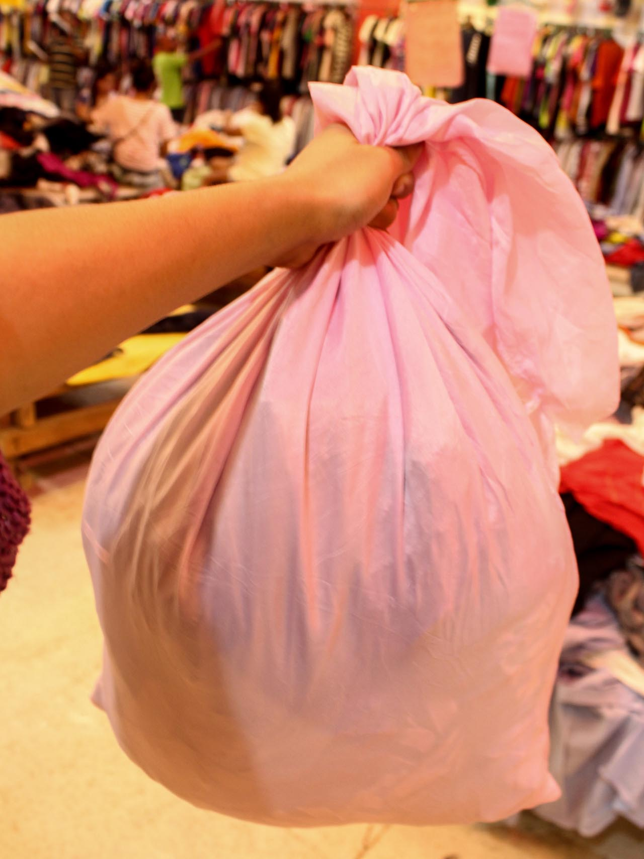 NO MORE SANDO BAGS. A local ukay-ukay store uses cloth sacks for purchases. Photo by Claudia Gancayco