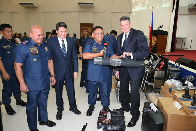 PNP, US TIES. PNP chief Director General Ronald dela Rosa is flanked by US embassy officials during the donation of antiterrorism equipment in September 2016. File photo from PNP PIO