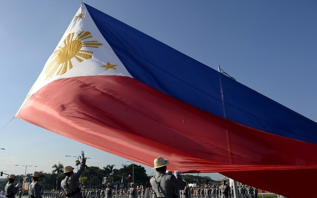 In this file photo, Philippine honor guards hoist a giant Philippine flag during the 119th death anniversary of national hero Jose Rizal at the Luneta Park in Manila on December 30, 2015. Noel Celis/AFP