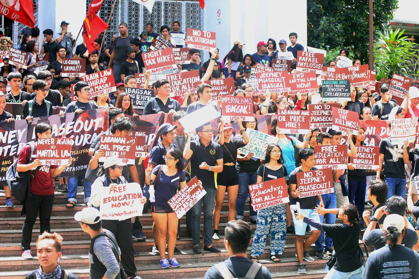 #WALKOUTPH. Students from the University of the Philippines walk out of their classes to join an anti-Duterte rally in front of UP Palma Hall in Diliman, Quezon City, on Friday, February 23 2018. The students are calling for the scrapping of the TRAIN Law and the jeepney modernization program, as well as a stop in the series of extra-judicial killings and harassment of journalists. Photo by Darren Langit/Rappler