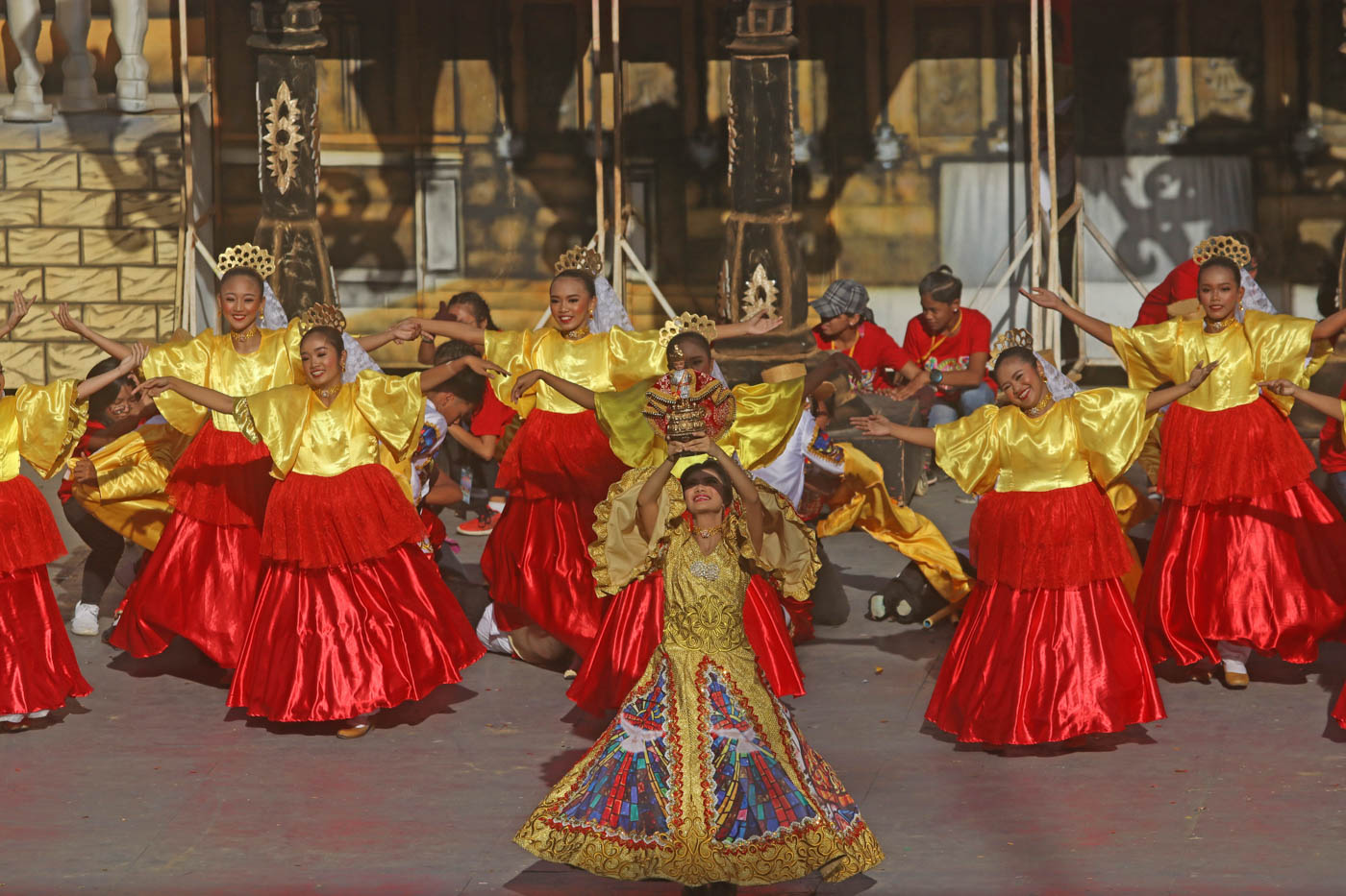 HOLY CHILD. A dance holds the Santo Niño above her head