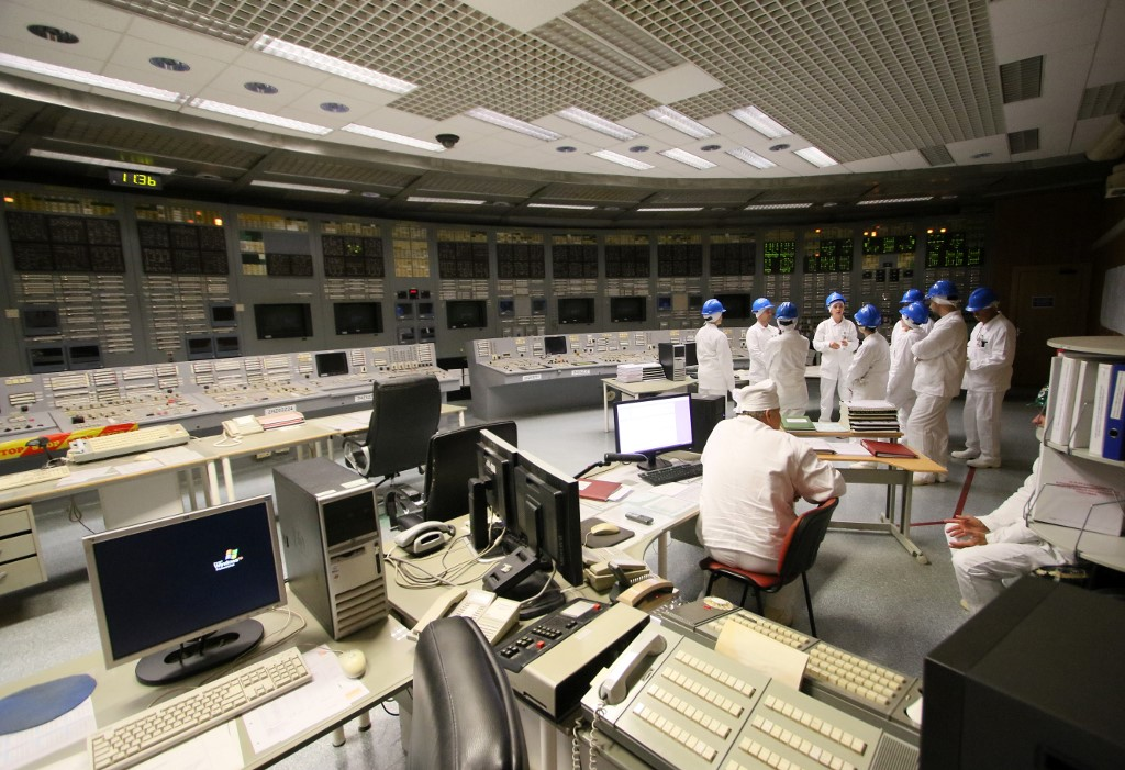 FEELING. People stand in the monitoring room during a guided tour inside the inoperative Ignalina nuclear power plant in Visaginas, Lithuania, on July 31, 2019. Photo by Petras Malukas / AFP