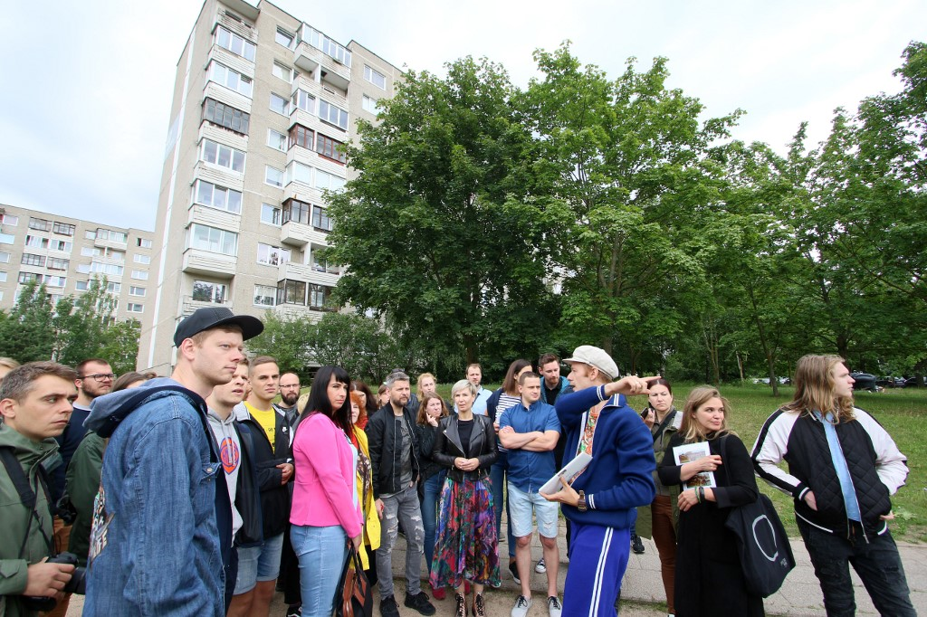 TOUR. People take part in a guided tour to the places where the HBO series 'Chernobyl was shot in the district Fabijoniskes in Vilnius, on July 13, 2019. Photo by Petras Malukas / AFP