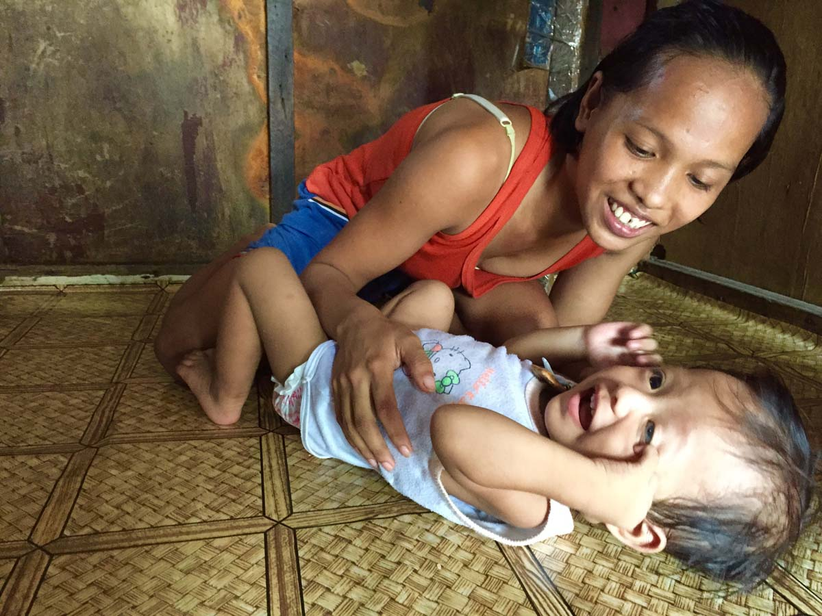 FAMILY. Bernadette plays with her son, Joel. Photo by Fritzie Rodriguez/Save the Children
