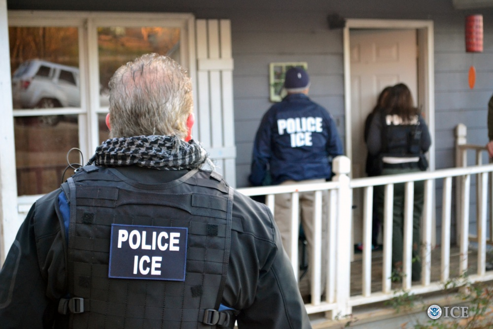 ICE agents visiting a home. File image courtesy US Immigration and Customs Enforcement