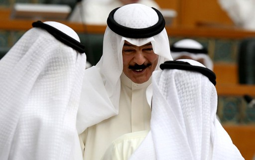 NEW DECREE. Kuwaiti Interior Minister Sheikh Mohammad Khaled Al-Sabah (C) talks with MPs during a parliament session in Kuwait City on July 3, 2016. File photo by Yasser al-Zayyat/AFP