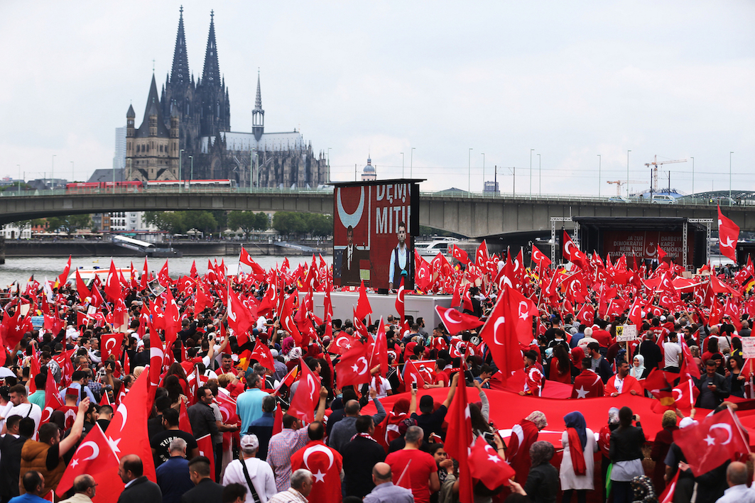 SUPPORT FOR ERDOGAN. Supporters wave Turkish flags during a pro-Erdogan rally in Cologne, Germany on July 31, 2016. File photo by Oliver Berg/EPA